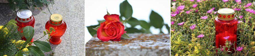 Punaisia hautakynttilöitä ja punainen ruusu.